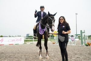 Ferry Wahyu Hadiyanto of Equinara Horse Sports, the winner of LSJ9 Show Jumping 140 cm Open class with Owner of Equinara Horse Sports, Mrs. Adinda Yuanita